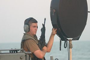 Long Range Acoustic Device - LRAD operator wearing hearing protection