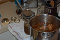 Ladling hot gumbo into jars for canning.jpg