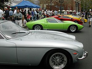 History of Lamborghini - The 400GT (foreground) featured an uprated 3.9-litre engine. The Miura (background) became Lamborghini's first mid-engined two-seater.