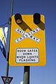 Level crossing boom gates advisory sign in Junee.jpg