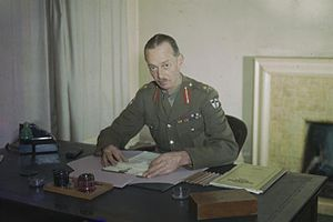 Miles Dempsey - Half length portrait of Lieutenant General Sir Miles Dempsey taken at his desk, April 1944.