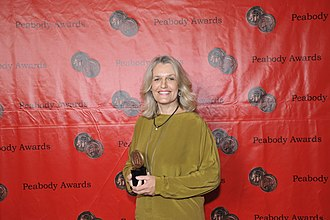 Burma VJ - Lise Lense-Moller holding award for Burma VJ at the 70th Annual Peabody Awards