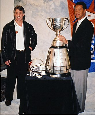 BC Lions - Lui Passaglia and Damon Allen with the Grey Cup in January 2001