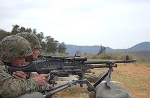 Medium machine gun - U.S. Marines firing an M240G at Camp Hansen, Okinawa