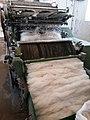 Machine processing pashmina wool, Leh.jpg