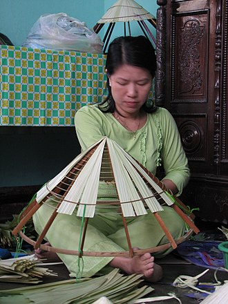 Asian conical hat - Making conical hats (nón lá) in Huế countryside, Vietnam