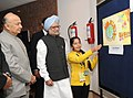 Manmohan Singh visiting the painting exhibition of National Painting Competition Prize winners, at the National Energy Conservation Day function, in New Delhi. The Union Power Minister.jpg