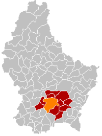 Map of Luxembourg with Luxembourg City highlighted in orange, the district in dark grey, and the canton in dark red