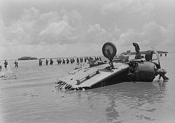 Marines move past wrecked Jap dive bomber on way to Agat beach on Guam. - NARA - 520965 (cropped).jpg