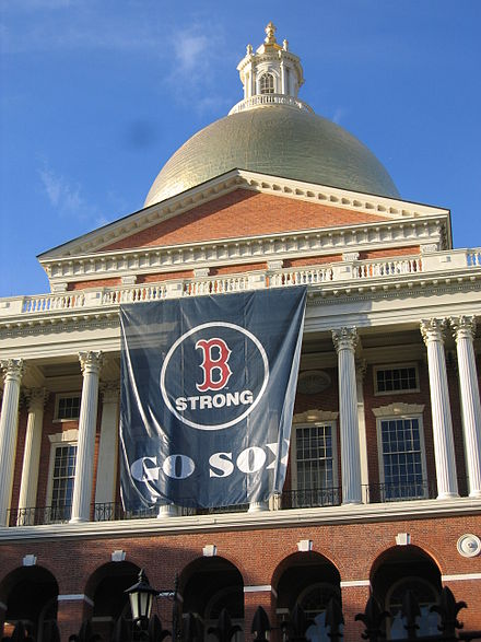 The Massachusetts State House displaying a banner in honor of the Red Sox's 2013 World Series appearance Massachusetts State House Red Sox Banner.JPG