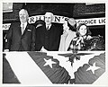 Mayor John F. Collins; John McCormack, Speaker of the House of Representatives; Mary Collins; daughter of John and Mary Collins in front of Amrheins Restaurant watching a St. Patrick's Day parade (12306414393).jpg