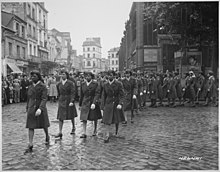 Members of the 6888th Central Postal Directory Battalion take part in a parade ceremony in honor of Joan d'Arc at the marketplace where she was burned at the stake.jpg