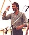 "Mick Ryan, UK folk musician on stage with ""Crows"", Towersey, 1980.jpg"