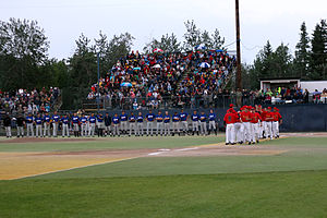 Alaska Goldpanners of Fairbanks - The players line up before the first pitch of the 2011 Midnight Sun Game.