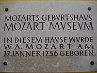 Plaque on wall outside Mozart's birthplace at Getreidegasse 9, Salzburg, Austria. It reads Mozart's Birth house, Mozart Museum. W.A. Mozart was born in this house on 27th of January 1756.