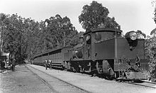 A WAGR Ms class Garratt locomotive with a passenger train at Mundaring Weir, 1930s.