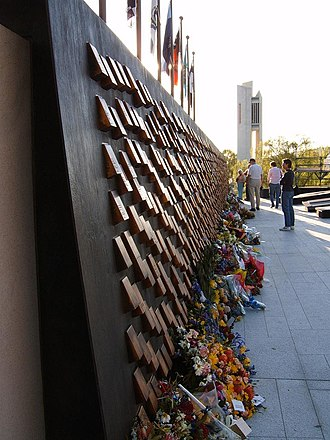 National Police Memorial Australia - National Police Memorial commemorative wall of 'touchstones' with National Carillon behind. Floral tributes laid at official opening, 29 September 2006.