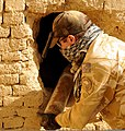 New Zealand Army 1st Lt. Nick Fisher, the officer in charge of the explosive ordnance detachment (EOD) of the New Zealand Provincial Reconstruction Team, removes a 107mm rocket from a wall in Bamiyan province 100830-A-QJ189-003.jpg