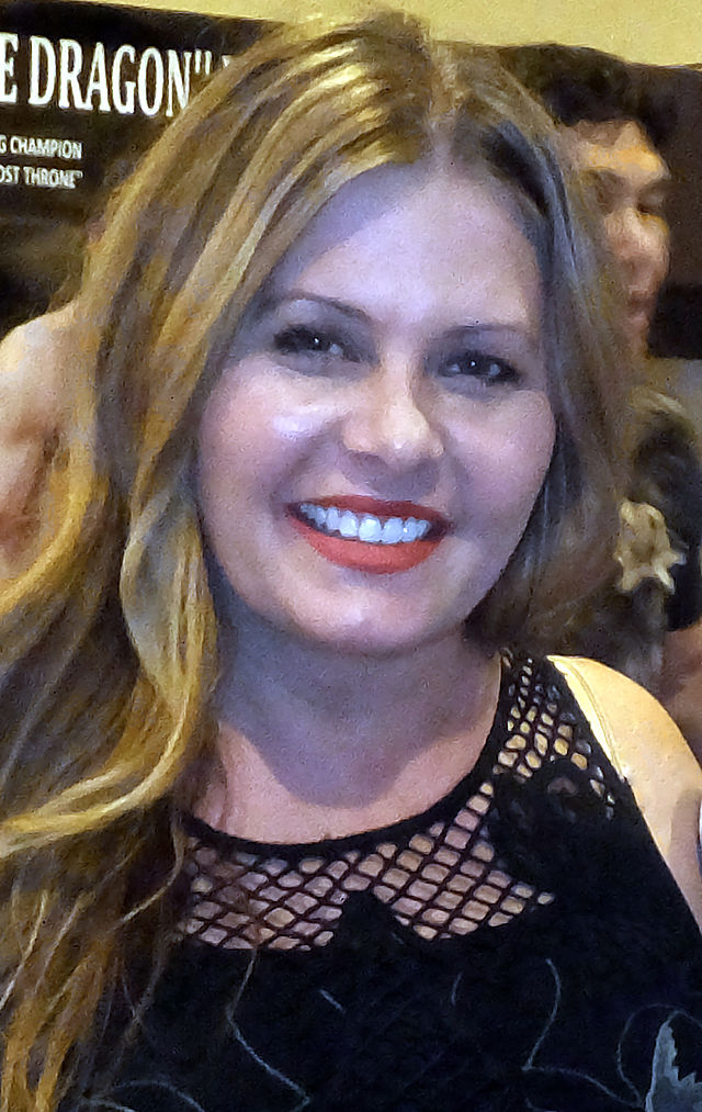 The 46-year old daughter of father Rolf Eggert and mother Gina Eggert, 157 cm tall Nicole Eggert in 2018 photo