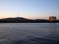 The Nishi Building and Black Mountain at sunset