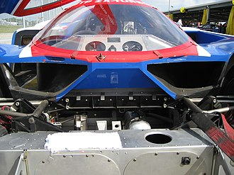 Nissan GTP ZX-Turbo - Ducting around the sides of the cockpit, air travels through the doors to the radiators. The footbox and pedals are exposed below.