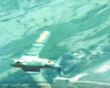 Blurry Gun camera photo shows a North Vietnamese MiG-17-fighter.