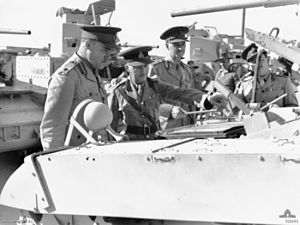 John Northcott - Northcott with officers of the Australian Army Ordnance Corps inspecting an American M3 Stuart Light Tank.
