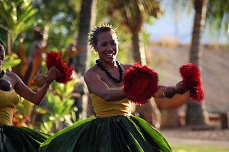 Hula - Hula dancers in a Luau in Lāhainā, in traditional kī leaf skirts