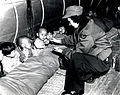 Orphans receive candy from Flight Nurse Capt. Mary Spivak.jpg