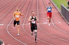 Oscar Pistorius sul traguardo dei 400 m a Varsavia nel 2011.