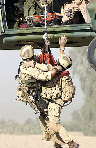 United States Air Force Pararescue - U.S. Air Force Pararescue personnel assigned to Baghdad International Airport (BIAP), perform a hoist extraction of a survivor during an Urban Operations Training Exercise (UOTE) at the Maltz training site, in support of Operation Iraqi Freedom, 2003.