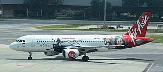 Indonesia AirAsia - Indonesia AirAsia wearing TAGG livery at Singapore Changi International Airport
