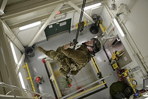 Francis S. Gabreski Air National Guard Base - Pararescuemen from the 103d Rescue Squadron rappel from the top of a parachute drying facility to conduct confined space rescue training at Francis S. Gabreski Air National Guard Base