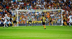 Player trying to head the ball into the goal