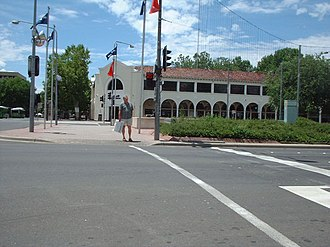 Pedestrian - A pedestrian at the intersection of Alinga Street and Northbourne Avenue, Canberra, Australia.