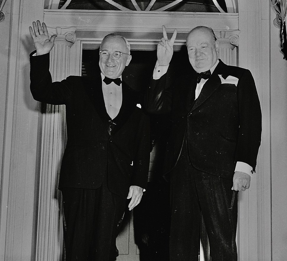 "Photograph of Winston Churchill flashing his ""V for Victory"" sign and President Truman waving outside Blair House in... - NARA - 200108 (cropped2)"