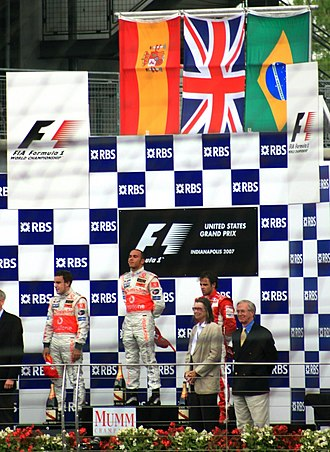 Lewis Hamilton - Hamilton on the top podium position after winning the 2007 United States Grand Prix. He is flanked by teammate Fernando Alonso (left) and Felipe Massa (right).