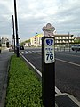 "Pole of Japan National Route 3 showing ""76 km to Moji"".jpg"