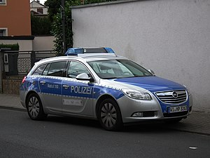 Law enforcement in Germany - An Opel patrol car of the Hesse State Police wearing the new silver/blue livery (including the reflective strips)