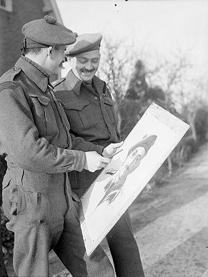 The Argyll and Sutherland Highlanders of Canada (Princess Louise's) - Private F.T.V. Savard shows Lieutenant-Colonel J.D. Stewart, Commanding Officer of The Argyll and Sutherland Highlanders of Canada, a portrait of Colonel Stewart which he is painting, Elshout, Netherlands, 17 December 1944.