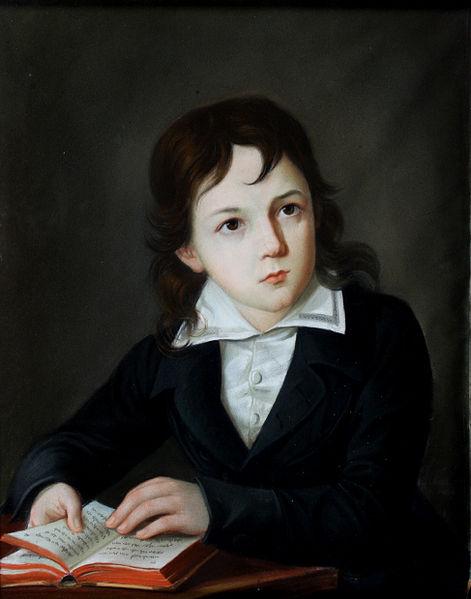 Файл: Портрет мальчика на его столе держит книгу 19c.jpg