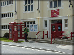 Stanley, Falkland Islands - The Port Stanley post office, with British red post and telephone boxes.