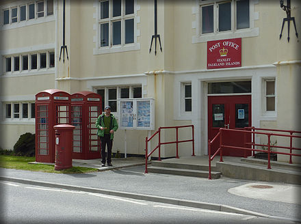 The Port Stanley post office, with British red post and telephone boxes. Post office (Stanley, Falkland Islands).jpg