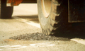 Pothole throw-and roll compaction of patch.png