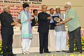 Pranab Mukherjee presenting the National Award for outstanding Services in the field of Prevention of Alcoholism and Substance (Drug) Abuse-2013 to Dr. Anil Awachat, Secretary, Muktangan Mitra, a de-addiction centre at Pune.jpg