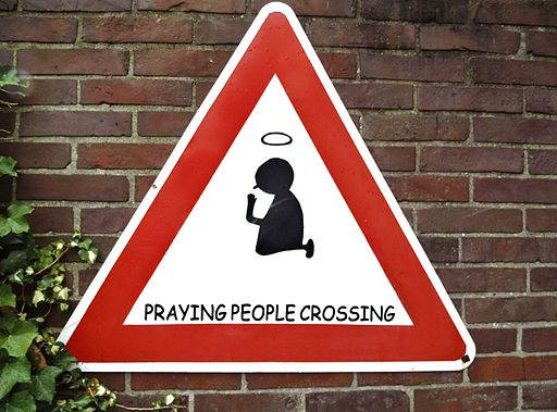 Praying people crossing