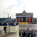 President John F. Kennedy on a platform overlooking the Berlin Wall at the Brandenburg Gate during his visit to West Berlin.jpg