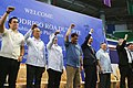 President Rodrigo Duterte and his delegation to Brunei raise their fists before the members of Filipino community at the indoor stadium of Hassanal Bolkiah National Sports Complex.jpg