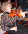 Priscilla McLean performing altered violin.png