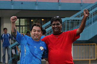 R. Vengadasalam - Admiralty FC team manager, R. Vengadasalam, and club owner, Donahue Francis, celebrate winning the Wolves' NFL Division 2 title on 30 June 2012.